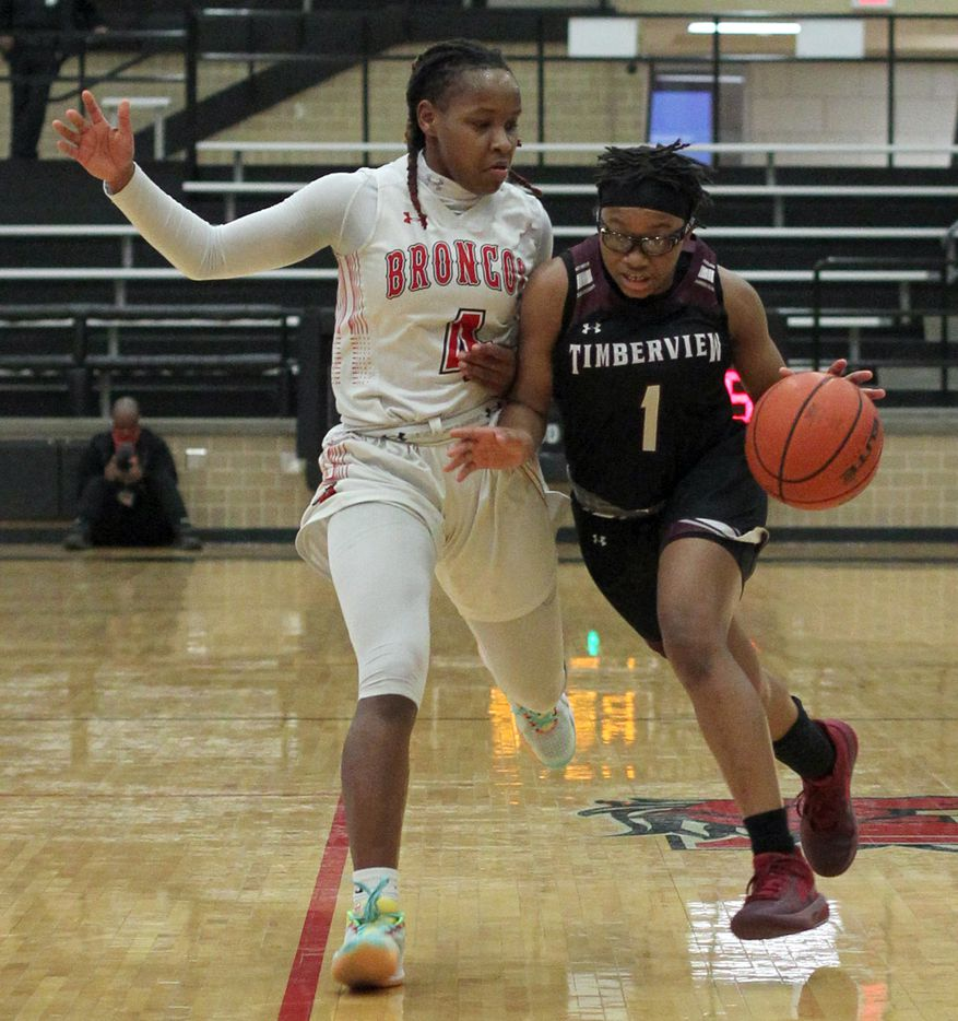Mansfield Timberview guard Tamara Mims (1) drives against the defense of Mansfield Legacy guard Sirviva Legions (4) during first half action. The two teams played their District 8-5A girls basketball game at Mansfield Legacy High school on January 22 , 2021. (Steve Hamm/ Special Contributor)