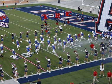 Allen players take the field against Evangel Christian Academy at Eagle Stadium in in 2016.