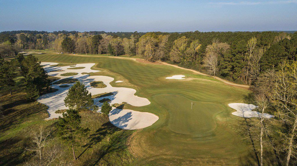 The par-5 second hold at Whispering Pines Golf Club in Trinity, Texas, plays 576 yards from the Spirit tees.  A massive bunker guards the right side of the fairway from the first landing zone to the green.