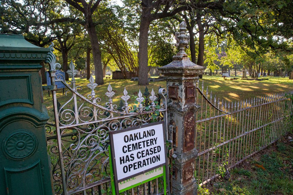 In this Thursday, Aug. 29, 2019 photo, a sign warns visitors at the Oakland Cemetery in the South Dallas area of Dallas, Texas of ceased operations on the property. The historic cemetery contains the graves of notable figures from the city's early beginnings.