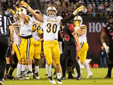 File - Wyoming linebacker Logan Wilson (30) celebrates a missed field goal by San Diego State during a game on Oct. 12, 2019, at SDCCU Stadium in San Diego, Calif. (Photo by Alan Smith/Icon Sportswire via Getty Images)