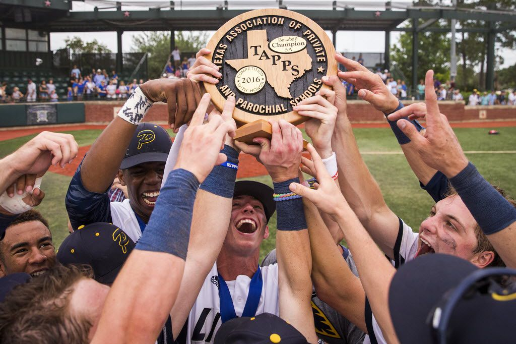 Prestonwood Christian players, including Ryan Cash (center), Eric Bullock (left) and Jonathan Heasley (right), lift the championship trophy after defeating Beaumont Kelly in the TAPPS 5A state championship baseball game at Baseball USA in Houston on Wednesday, May 25, 2016. Prestonwood Christian won the game 7-1. (Smiley N. Pool/The Dallas Morning News)