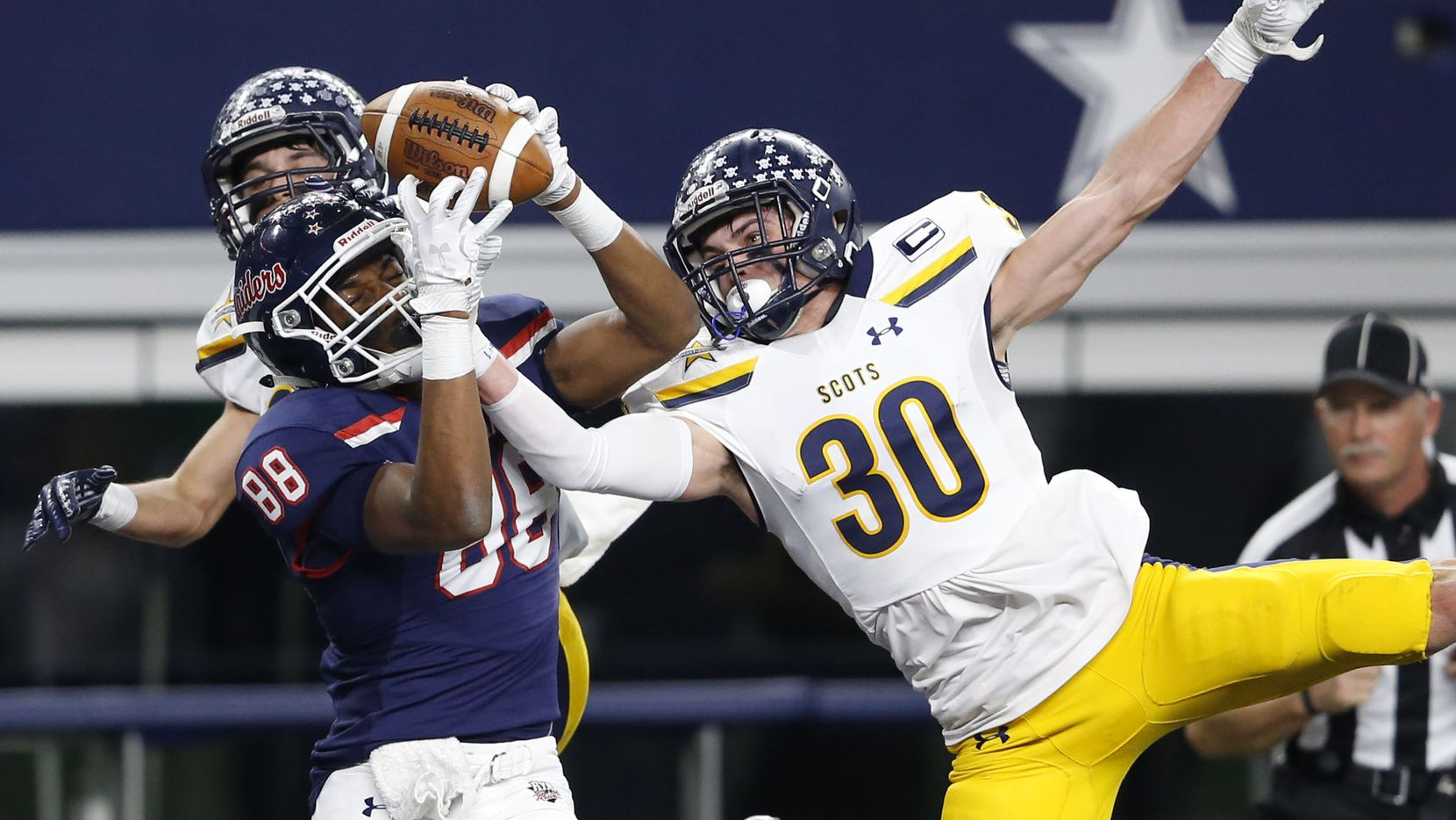 Denton Ryan's Chritauskie Dove (88) catches a pass for a touchdown despite the effort from Highland Park's James Herring (30) on defense during the first half of play in a Class 5A Division I state semifinal at AT&T Stadium in Arlington, on Friday, December 15, 2017.