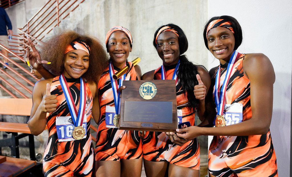 Te winning Lancaster girls 4X200 relay team poses with their trophy at the 5A UIL State Championships on a cool Friday Friday night in Austin.  Lancaster finished with a time of 1 minute, 37.34 seconds. (Bob Daemmrich/Special Contributor)