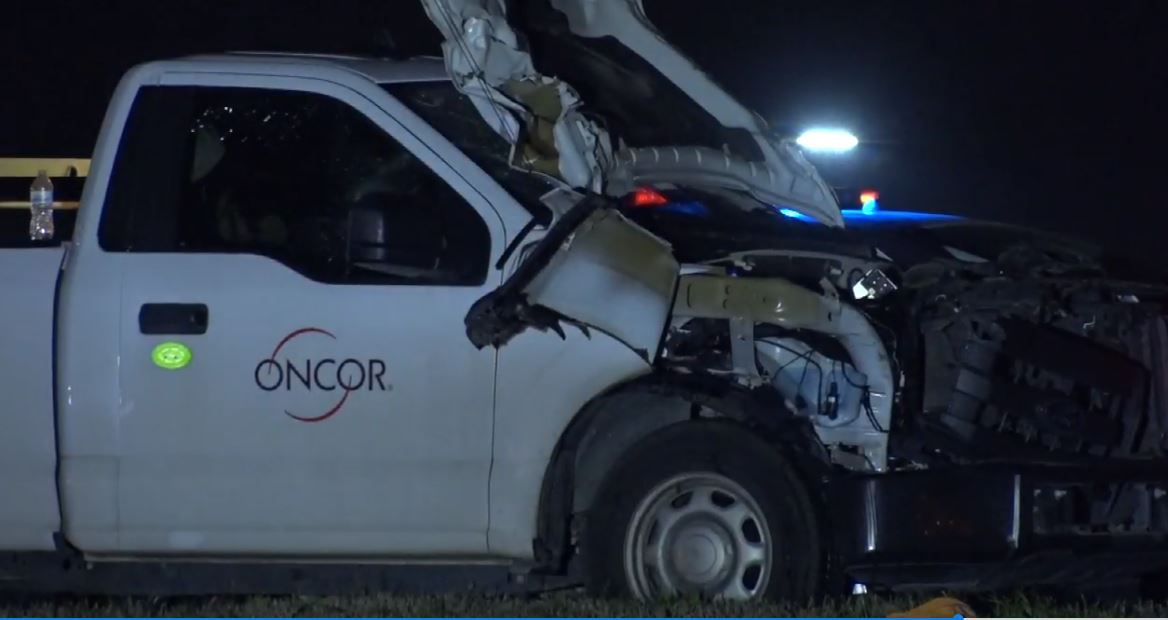 An Oncor truck was heavily damaged after a wreck in which a pedestrian was killed Wednesday in Red Bird.