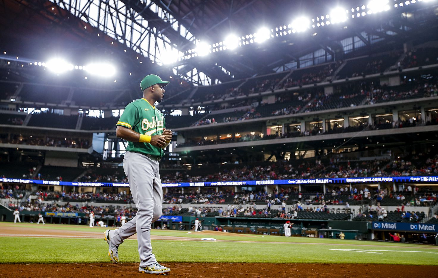 Oakland Athletics shortstop Elvis Andrus (17) heads to the dugout before the start of a baseball game against the Texas Rangers in Arlington, Monday, June 21, 2021. (Brandon Wade/Special Contributor)