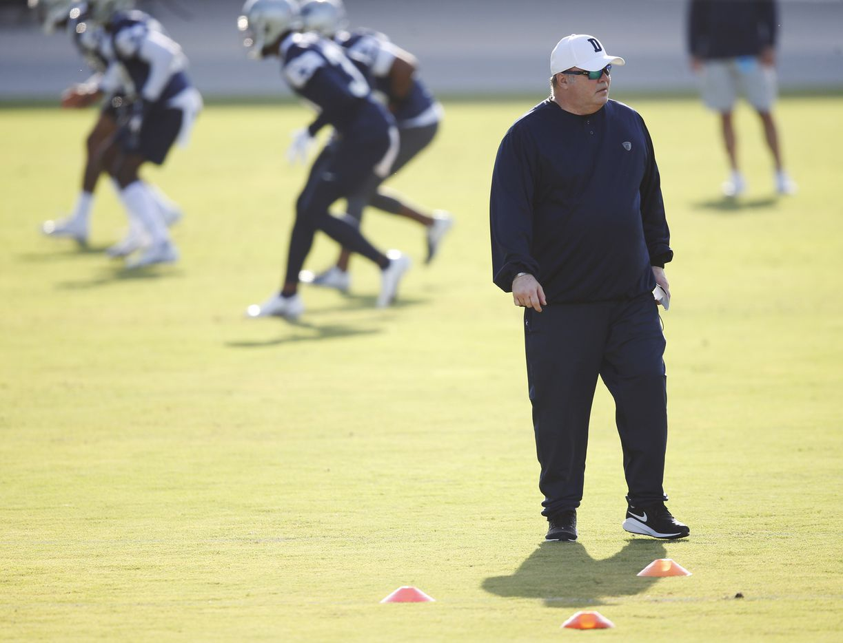 Dallas Cowboys head coach Mike McCarthy watches practice on the first day of training camp at Dallas Cowboys headquarters at The Star in Frisco, Texas on Friday, August 14, 2020. (Vernon Bryant/The Dallas Morning News)