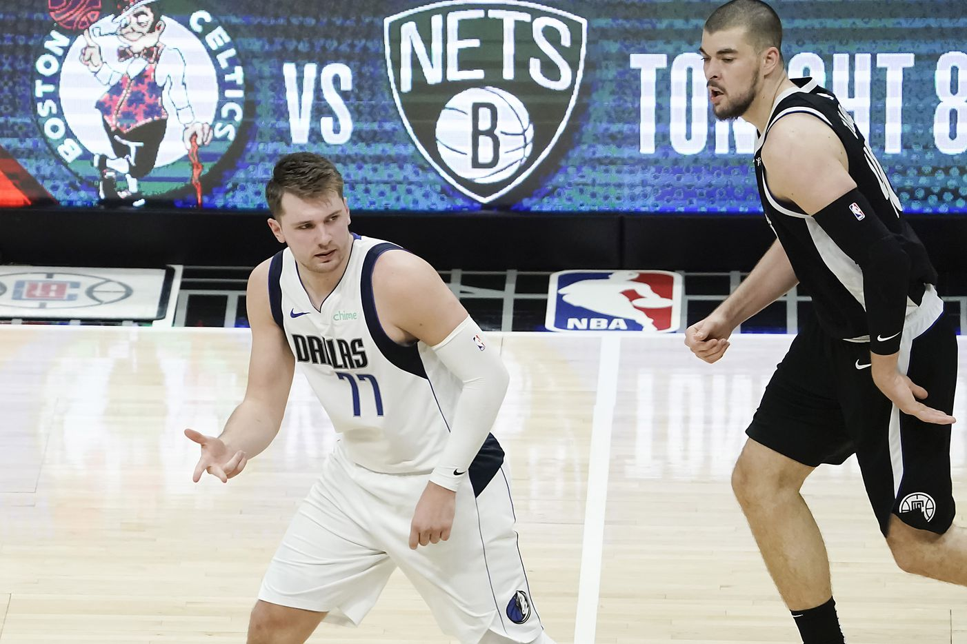 Dallas Mavericks guard Luka Doncic reacts after making a 3-pointer as LA Clippers center Ivica Zubac (40) looks away during the first half of an NBA basketball game at Staples Center on Saturday, May 22, 2021, in Los Angeles.