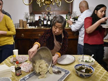 Zhen Hua, 78, serves a batch of freshly boiled pork dumplings during a Chinese New Year party in Dallas on Saturday, Feb. 2, 2020.