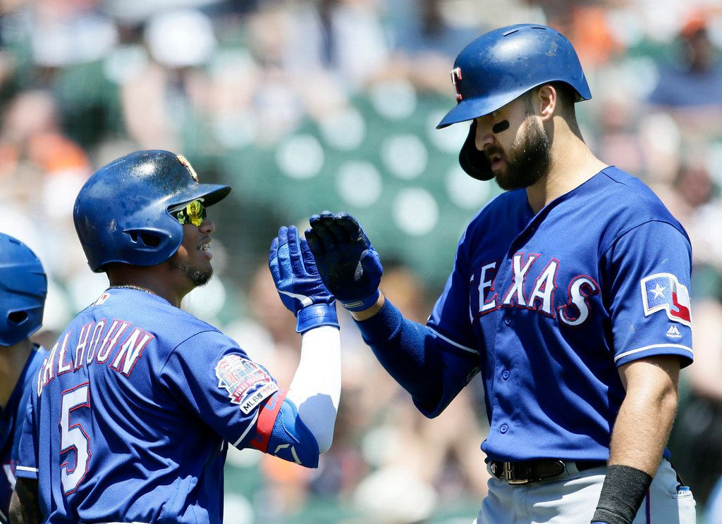 DETROIT, MI - JUNE 27:  Joey Gallo #13 of the Texas Rangers receives a high-five from Willie Calhoun #5 of the Texas Rangers after hitting a solo home run against the Detroit Tigers during the fourth inning at Comerica Park on June 27, 2019 in Detroit, Michigan. The Rangers defeated the Tigers 3-1. (Photo by Duane Burleson/Getty Images)