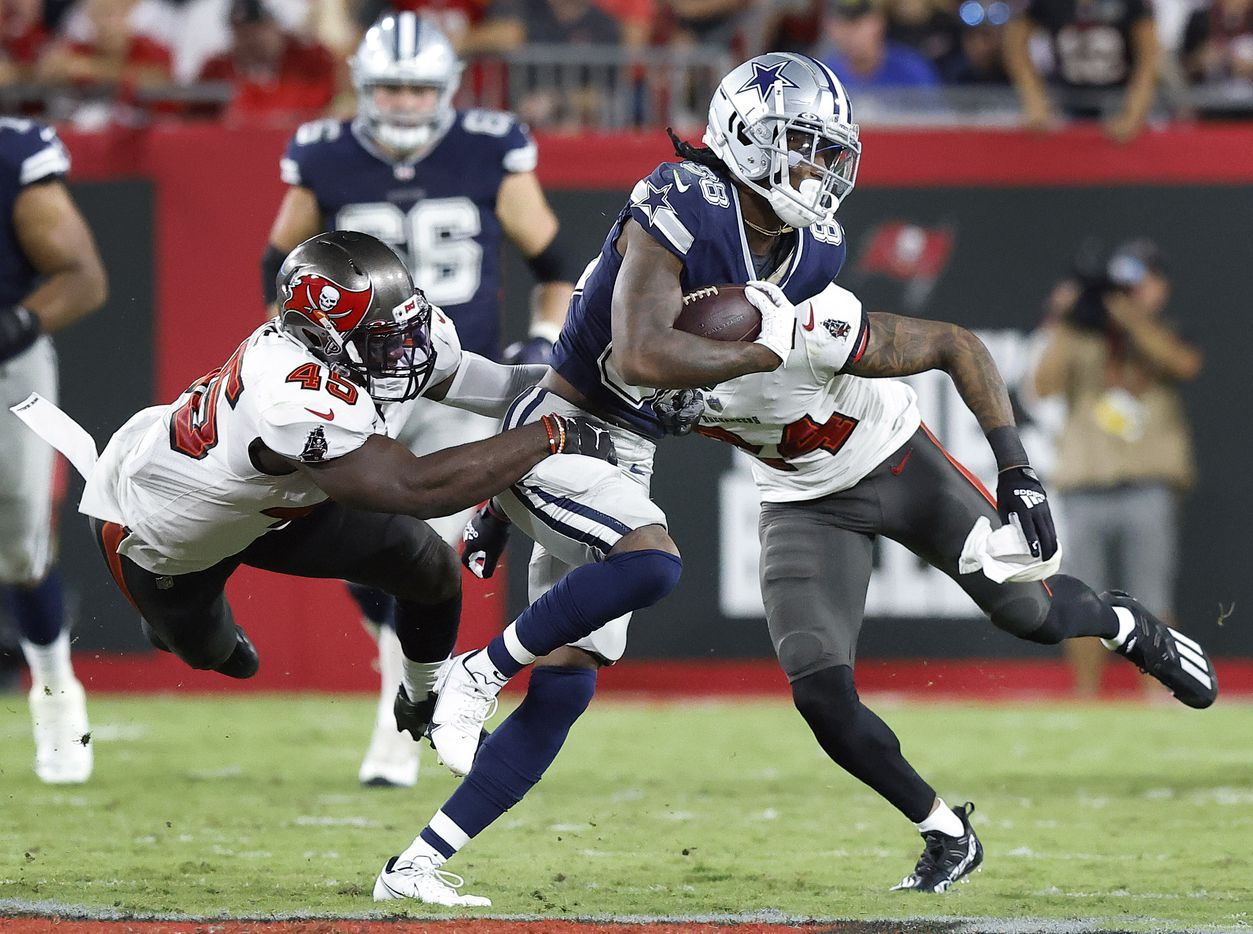 Tampa Bay Buccaneers linebacker Devin White (45) tries to make a tackle of Dallas Cowboys wide receiver CeeDee Lamb (88) after a pass reception in the second quarter at Raymond James Stadium in Tampa, Florida, Thursday, September 9, 2021. Also covering on the play was Tampa Bay Buccaneers cornerback Carlton Davis (24). The Cowboys faced the Tampa Bay Buccaneers in the NFL season opener. (Tom Fox/The Dallas Morning News)