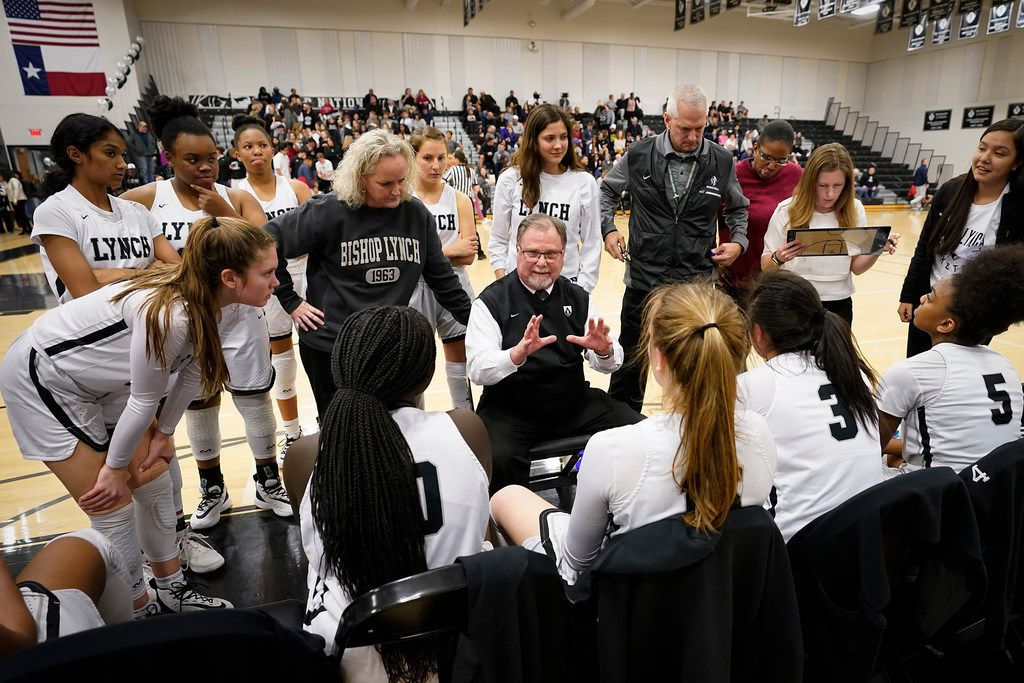 File photo of Bishop Lynch players huddle around head coach Andy Zihlman during a time out in a TAPPS 2-6A high school girls basketball game against Prestonwood Christian on Friday, Feb. 7, 2020, in Dallas.