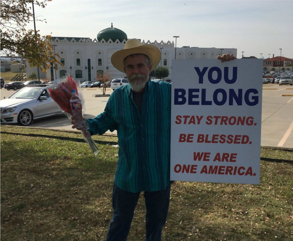"""Justin Normand, a 53-year-old man who lives and works in Dallas, identified himself Monday as the man holding the sign. He said he had the urge to """"share peace with [his] neighbors"""" after the election results rolled in Nov. 9., so he went out on his own last weekend and did just that."""