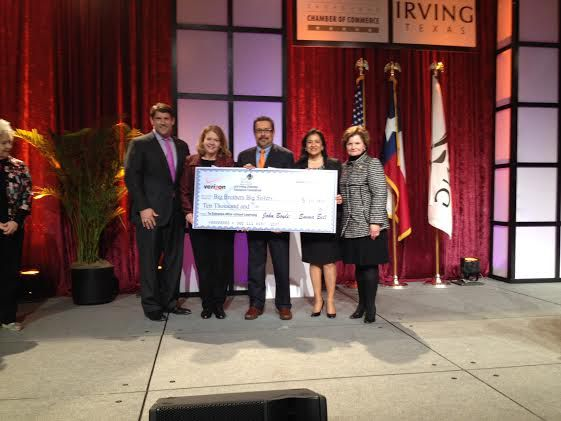 One Irving presents a $10,000 check to Big Brothers Big Sisters at the State of the City presentation.
