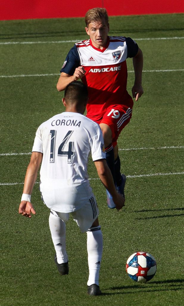 FC Dallas midfielder Paxton Pomykal (19) charges defensively against the offensive pursuit of LA Galaxy midfielder Joe Corona (14) during second half play. FC Dallas won the contest, 2-0. The two Major League Soccer teams played their game at Toyota Stadium in Frisco on March 9, 2019. (Steve Hamm/ Special Contributor)