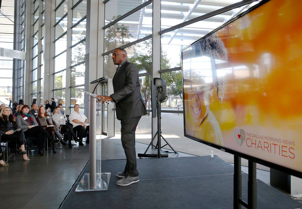 Former NFL player Tim Brown, honorary chairman of The Dallas Morning News Charities, addresses the crowd during a kickoff event for the 2018-19 campaign at the Winspear Opera House in Dallas on Wednesday.