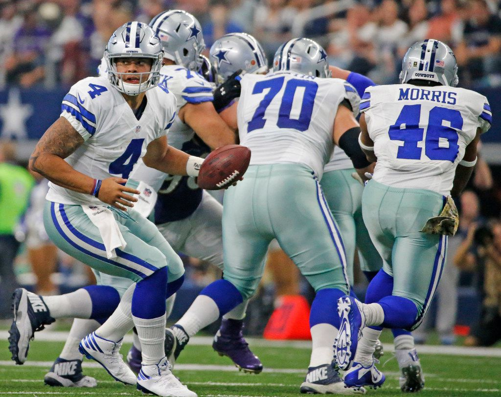 Dallas Cowboys quarterback Dak Prescott (4) is pictured behind a wall of blockers during the Baltimore Ravens vs. the Dallas Cowboys NFL football game at AT&T Stadium in Arlington, Texas on Sunday, November 20, 2016. (Louis DeLuca/The Dallas Morning News)