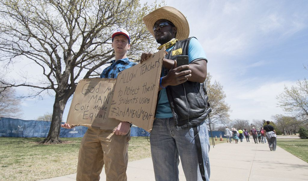 "Pro-gun advocates Trevor Jackson and a man who gave his name as ""The Black Rebel"" were at the March for Our Lives rally in Oklahoma City."