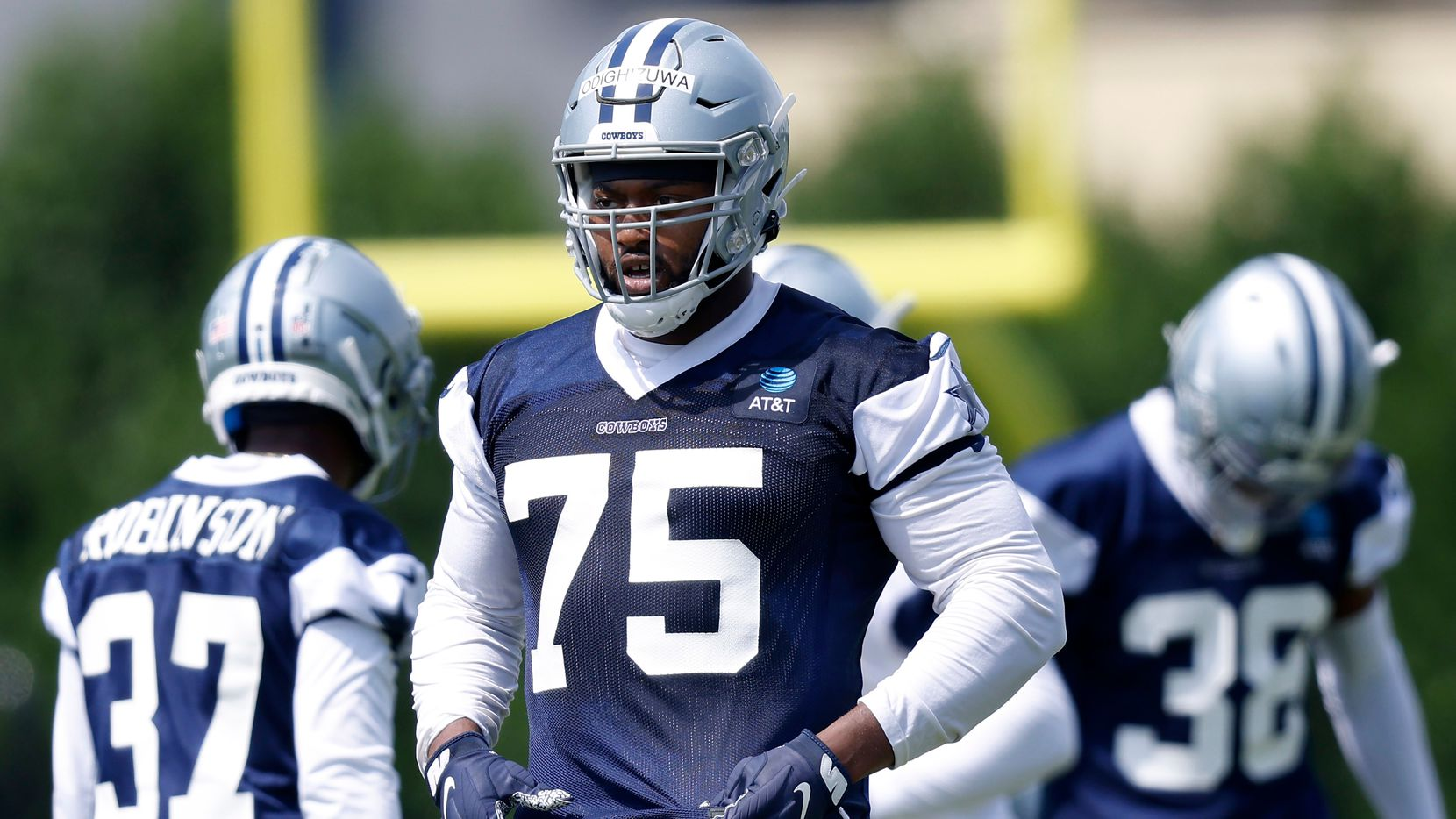 Dallas Cowboys rookie defensive tackle Osa Odighizuwa (75) waits to run another play during team drills at rookie minicamp at The Star in Frisco, Texas, Saturday, May 15, 2021. (Tom Fox/The Dallas Morning News)
