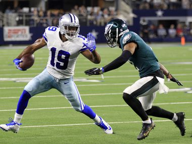 Dallas Cowboys wide receiver Amari Cooper (19) tries to elude a Philadelphia Eagle defender, after a catch, during the first half of a NFL football game at AT&T Stadium in Arlington on Monday, September 27, 2021.