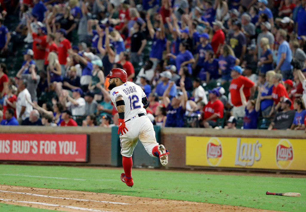 Fans stand and cheer as Texas Rangers' Rougned Odor rounds the bases after hitting a game-winning solo home run off Detroit Tigers reliever Nick Ramirez in the 10th inning of a baseball game in Arlington, Texas, Saturday, Aug. 3, 2019. The Rangers won 5-4. (AP Photo/Tony Gutierrez)