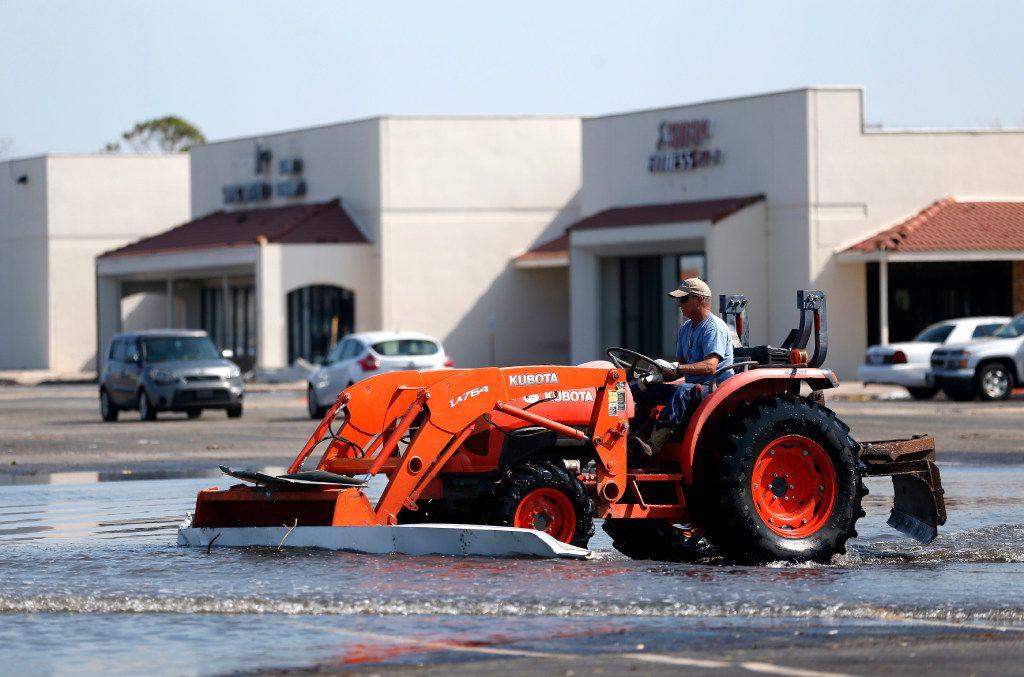 Scott Coulter from Edna moves debris across a strip mall parking lot in Rockport on Thursday, Aug. 31, 2017. Texas' coastal region suffered severe damage after Hurricane Harvey hit on Aug. 26.