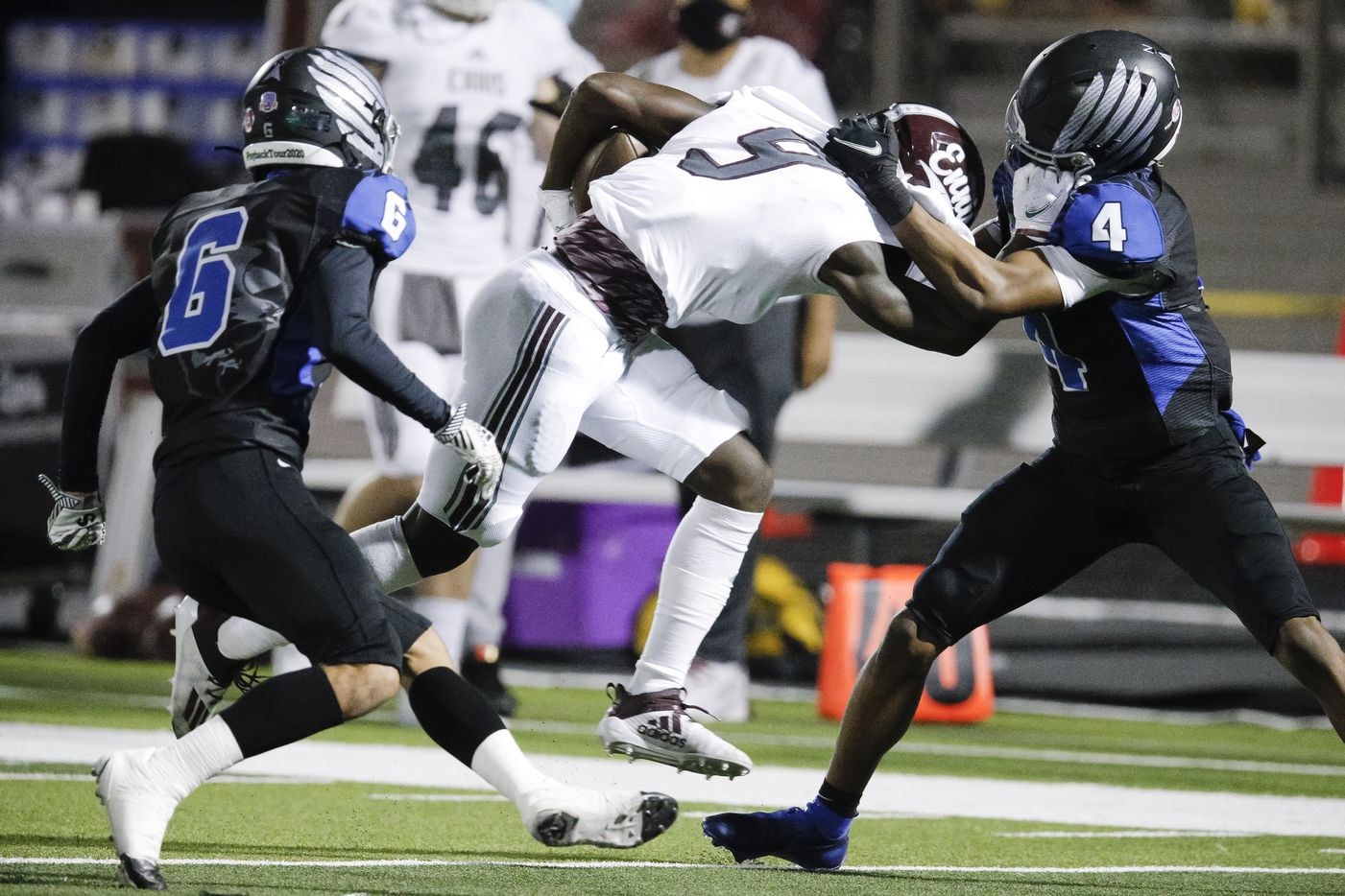 Ennis junior wide receiver Devion Beasley (9) battles North Forney senior defensive back Emarlyee Stewart (4) for space during the first half of a high school playoff football game in Forney, Thursday, November 19, 2020. (Brandon Wade/Special Contributor)