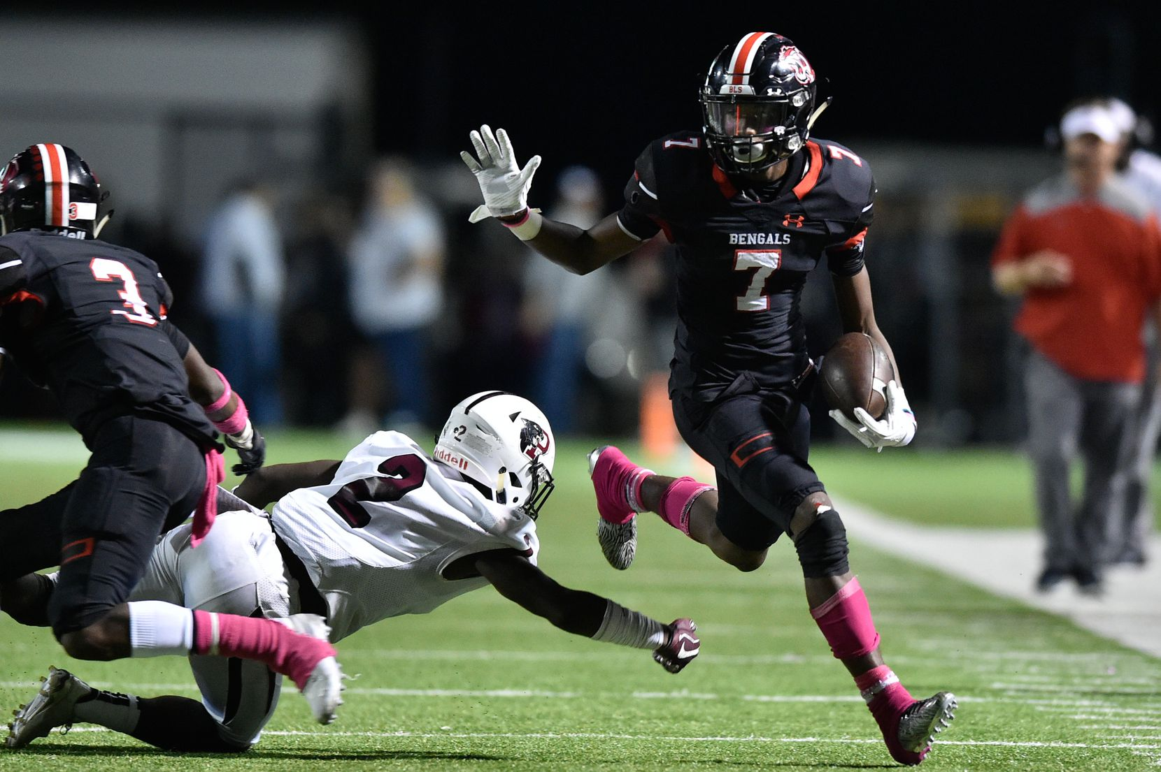 Braswell wide receiver Cam Smith (7) runs after a catch and avoids being tackled by Princeton defensive back C.J. Washington (2) at C.H. Collins Athletic Complex.