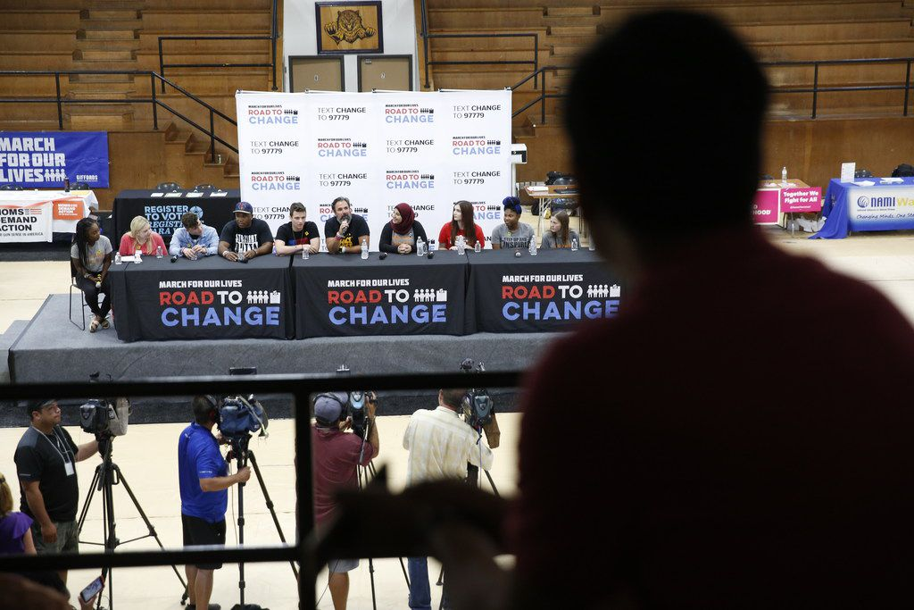 The crowd watches a panel with students from Stoneman Douglas High School in Parkland, Fla., at Paul Quinn College in Dallas on July 7, 2018.