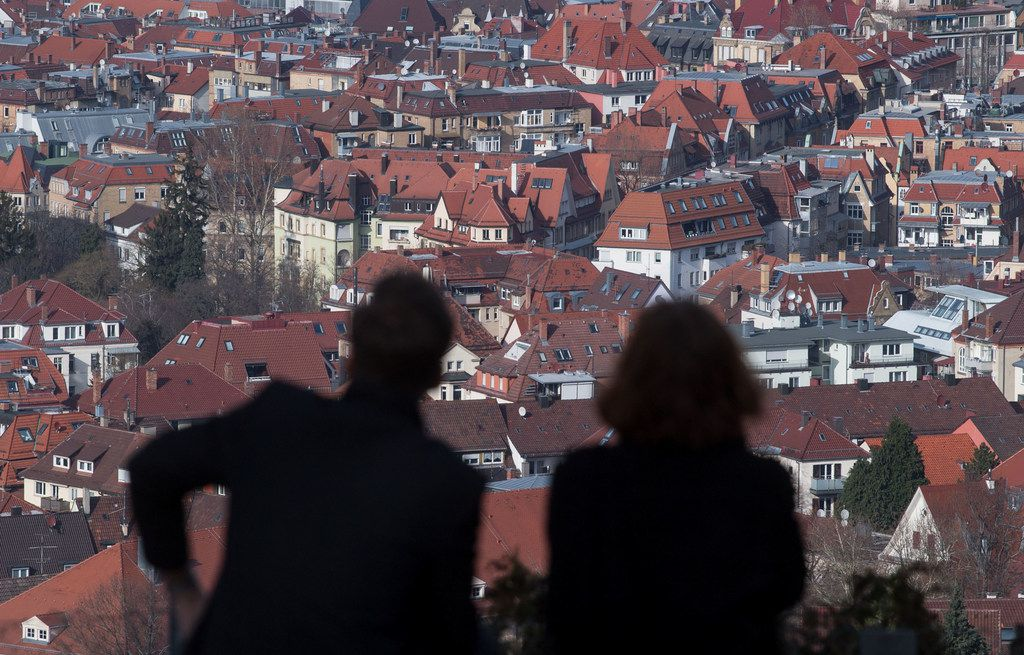 A couple checks out the southern German city of Stuttgart from a view point.