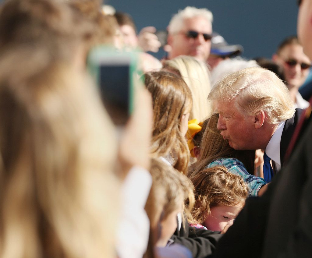 President Donald Trump greets supporters after arriving at Love Field in Dallas Wednesday October 25, 2017. President Trump will participate in a hurricane recovery briefing, a Republican National Committee roundtable and give remarks at a reception. (Andy Jacobsohn/The Dallas Morning News)