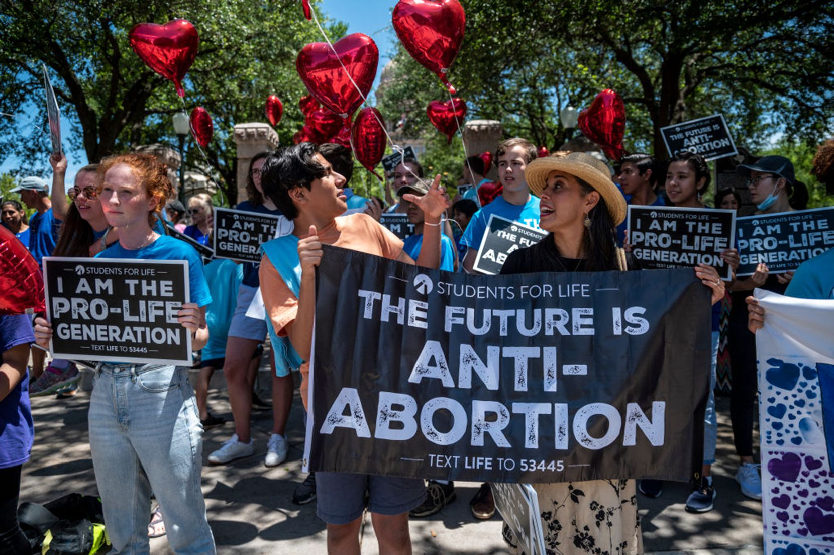Pro-life protesters stand near the gate of the Texas Capitol on May 29, 2021.