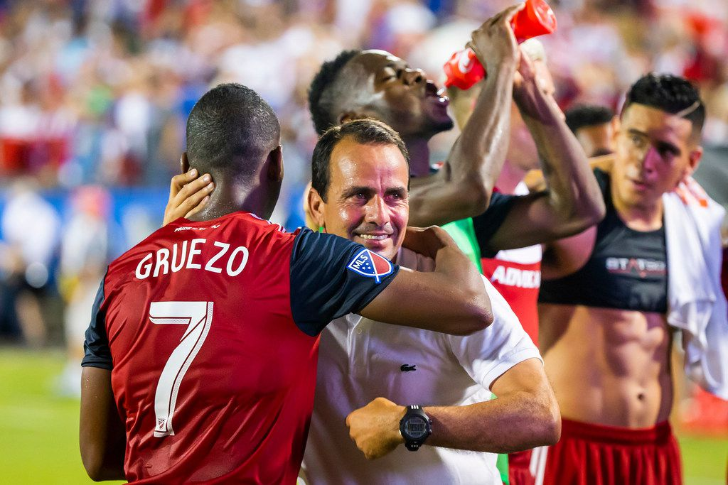 FC Dallas coach Oscar Pareja hugs midfielder Carlos Gruezo after a win over Atlanta United on Wednesday, July 4, 2018, in Frisco, Texas. FC Dallas won the game 3-2.  (Smiley N. Pool/The Dallas Morning News)