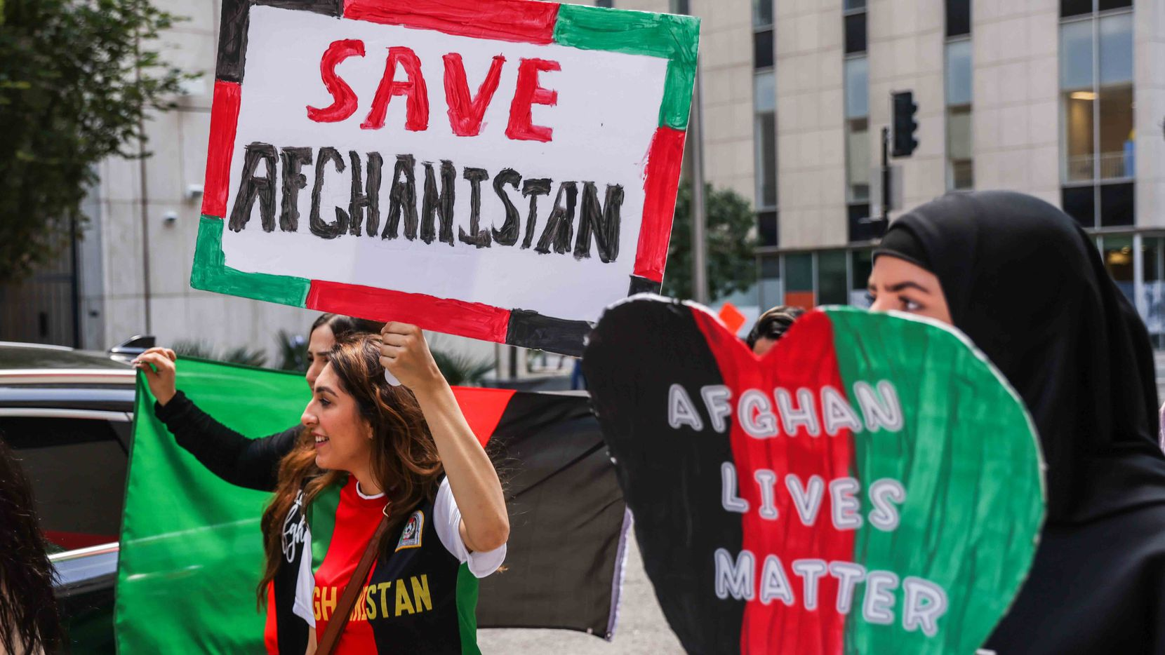 Demonstrators marched through part of downtown Dallas on Saturday, Aug. 21, 2021, to call for more help by the U.S. to evacuate thousands of Afghans desperate to get out of the war-ravaged country.