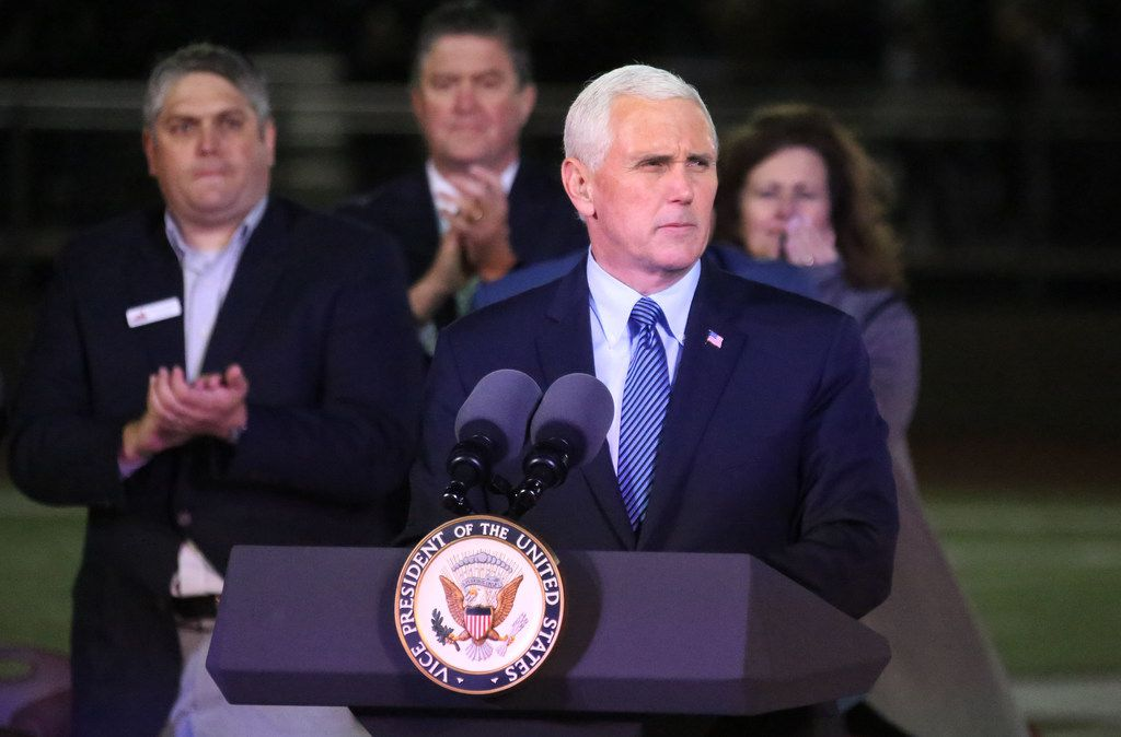 United States Vice President Mike Pence is applauded after his remarks at a memorial service at the Floresville High School football stadium in Floresville, Texas. Photographed on Wednesday, November 8, 2017. (Louis DeLuca/The Dallas Morning News)