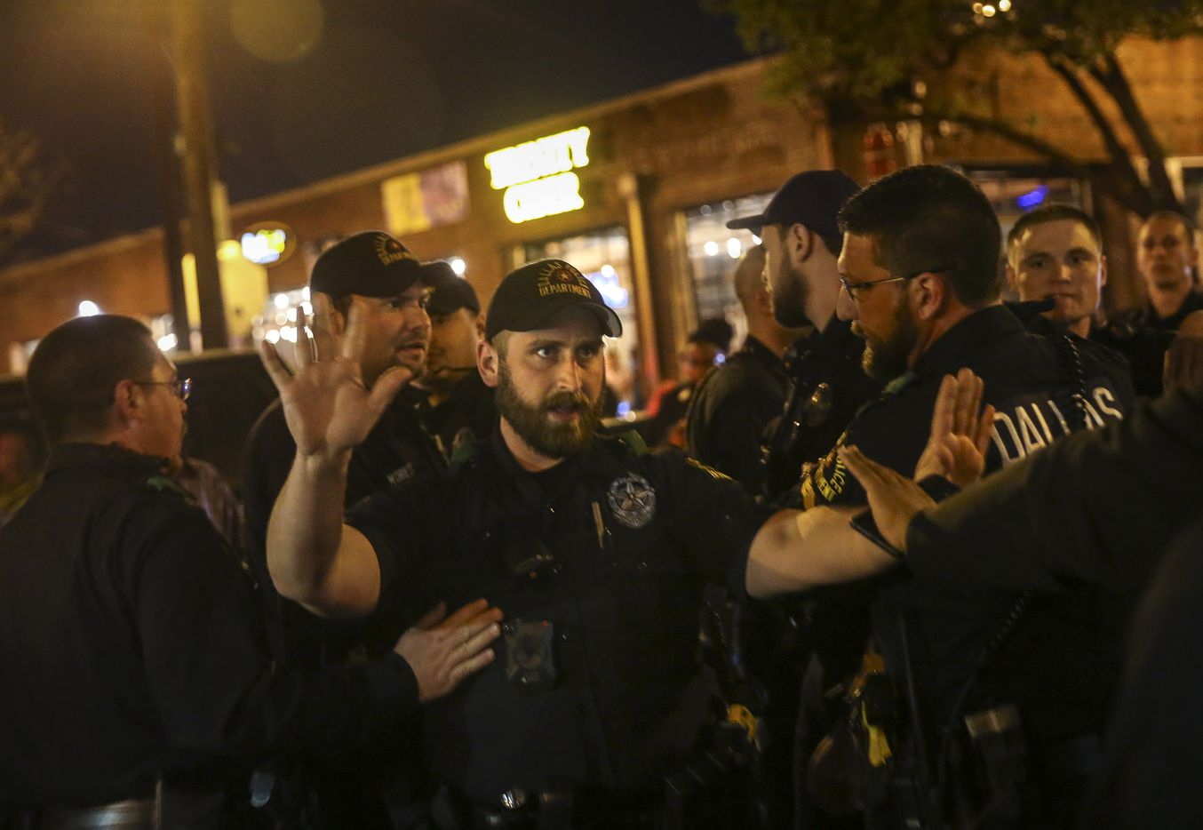 Police break up a dispute during a protest Saturday, March 23, 2019 in Dallas' Deep Ellum neighborhood.