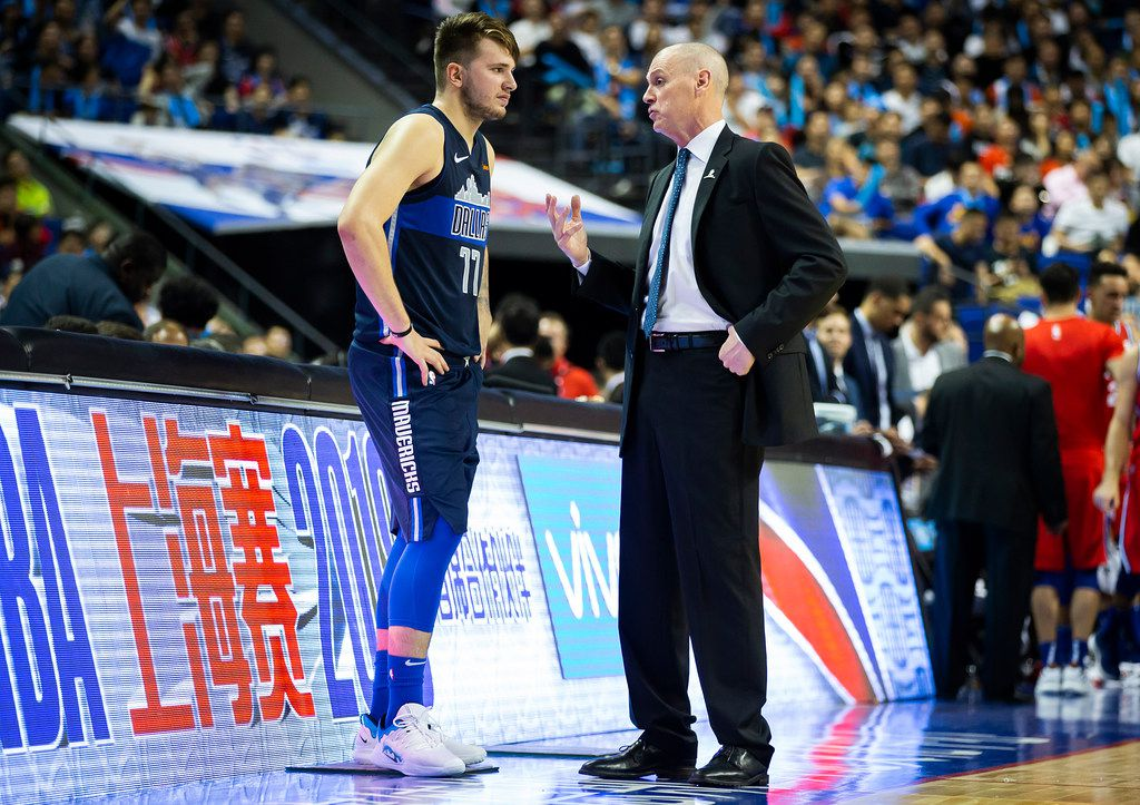 Dallas Mavericks guard Luka Doncic (77) talks with head coach Rick Carlisle before checking into the game after a timeout during the second half of an NBA China Games 2018 preseason basketball game against the Philadelphia 76ers at Mercedes-Benz Arena on Friday, Oct. 5, 2018, in Shanghai. (Smiley N. Pool/The Dallas Morning News)