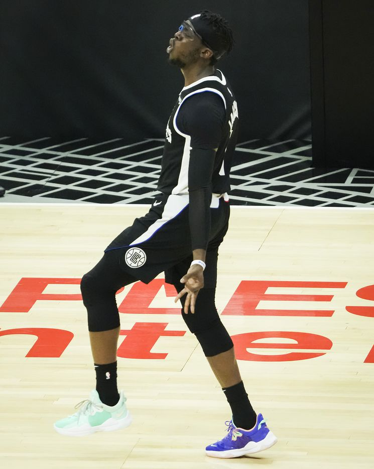LA Clippers guard Reggie Jackson (1) celebrtes after making a 3-pointer during the fourth quarter of Game 7 of an NBA playoff series against the Dallas Mavericks at the Staples Center on Sunday, June 6, 2021, in Los Angeles.