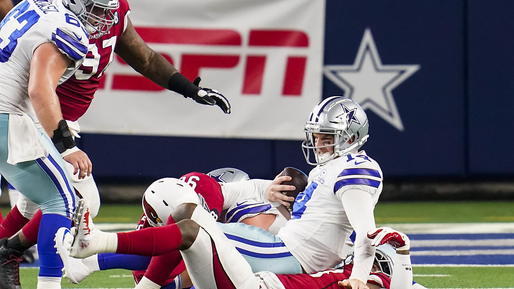 Dallas Cowboys quarterback Andy Dalton (14) is sacked by Arizona Cardinals outside linebacker Haason Reddick (43) during the second quarter of an NFL football game at AT&T Stadium on Monday, Oct. 19, 2020, in Arlington.