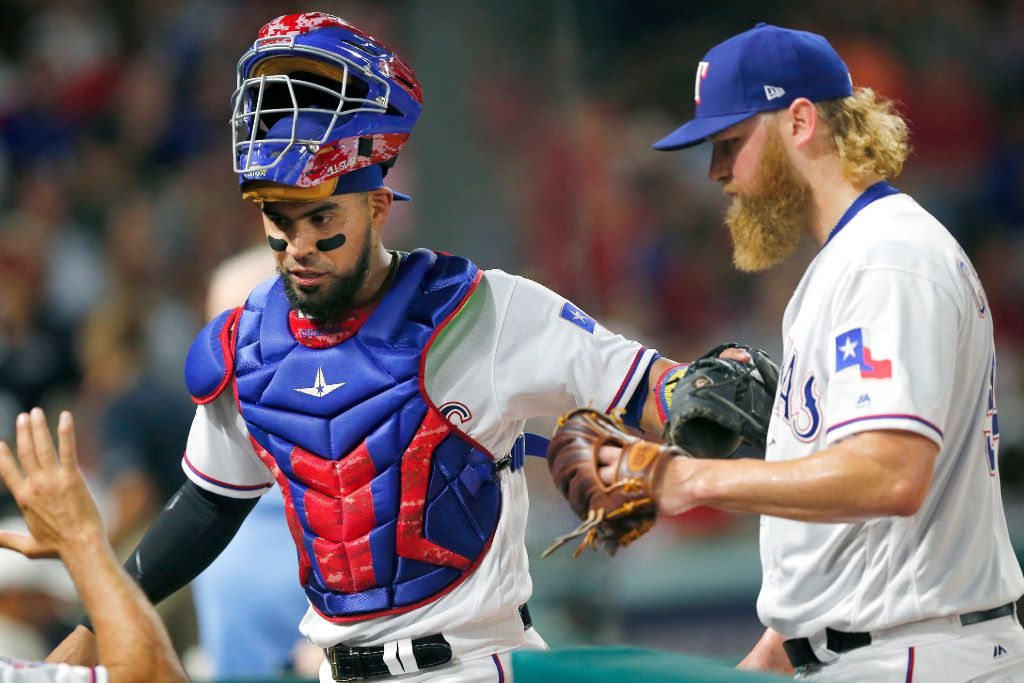 Texas Rangers catcher Robinson Chirinos (61, left) congratulates starting pitcher Andrew Cashner (54) on his seventh inning outing against  the Baltimore Orioles at Globe Life Park in Arlington, Friday, July 28, 2017. (Tom Fox/The Dallas Morning News)