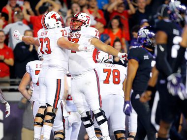 FILE - Texas Tech offensive linemen Dawson Deaton (73) and Jacob Hines (77) chest bump after quarterback Jett Duffey scored a game-winning touchdown against TCU at Amon G. Carter Stadium in Fort Worth on Thursday, Oct. 11, 2018.