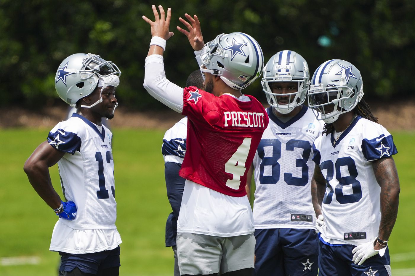 Dallas Cowboys quarterback Dak Prescott (4) talks with wide receivers,  Michael Gallup (13), Amari Cooper, Brennan Eagles (83)  CeeDee Lamb (88) during a minicamp practice at The Star on Tuesday, June 8, 2021, in Frisco. (Smiley N. Pool/The Dallas Morning News)