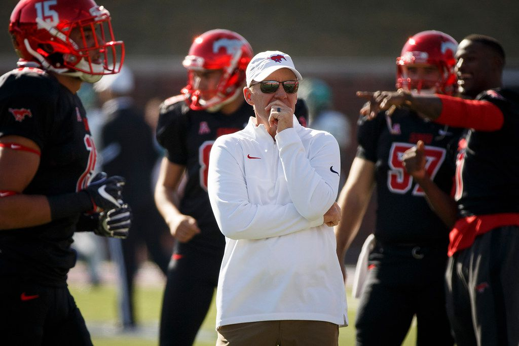 SMU head coach Chad Morris watches his team warm up before an NCAA football game against Tulane at Ford Stadium on Saturday, Nov. 25, 2017, in Dallas. (Smiley N. Pool/The Dallas Morning News)