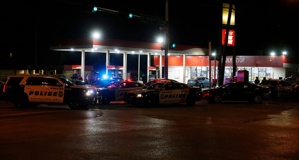 Dallas Police investigate the scene of a shooting where a 13-year-old boy died after being caught in crossfire near a Pleasant Grove gas station in the 9400 block of Bruton Avenue in Dallas on Tuesday, June 4, 2019. Dallas Police initially identified the child as age 14, but the Dallas County Medical Examiner early Wednesday identified him as Malik Tyler, age 13.