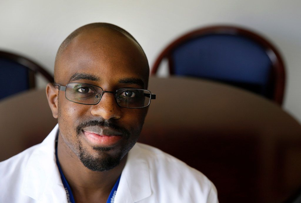 Dr. Dale Okorodudu, M.D. poses for a portrait at UT Southwestern Medical Center in Dallas on Wednesday, July 2, 2019. Okorodudu is working to increase the number of black men in medicine through his work and brand, Black Men in White Coats.