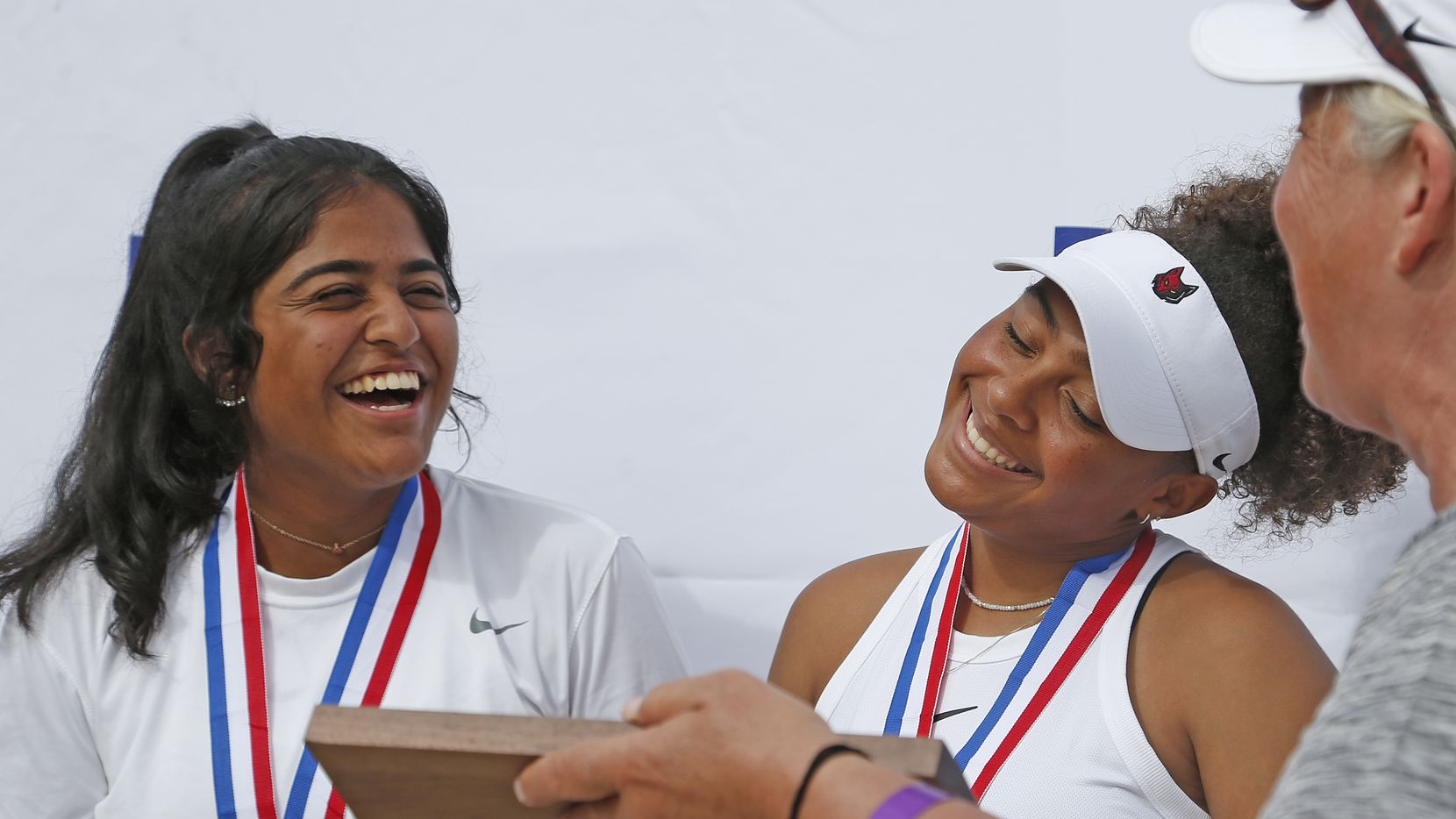 Saundarya Vedula (left( and Tamiya Lintz after they won the 5A girls doubles UIL State Tennis finals at Northside Tennis on Friday, May 21, 2021.