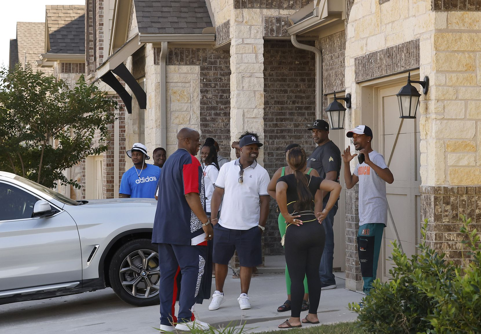 Family and friends of Timothy George Simpkins, 18, who was named as the suspect in the shooting at Timberview High School yesterday, gather outside his Arlington,Texas home Thursday, October 7, 2021. Simpkins was released from the Tarrant County jail.