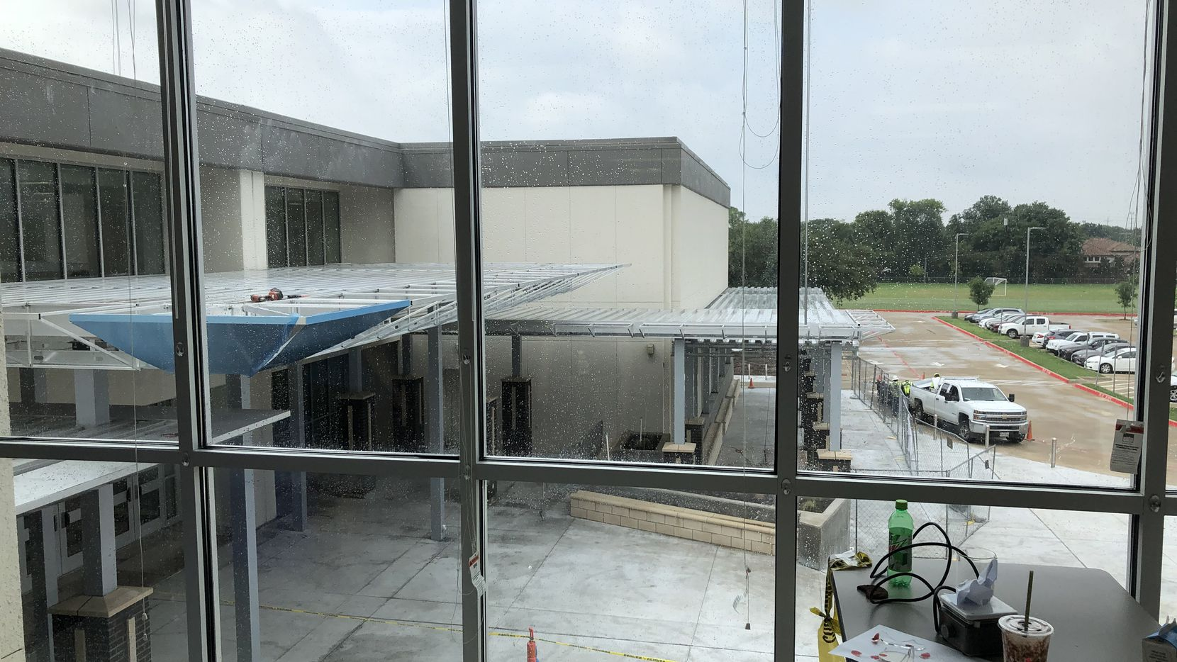 Natural light streams into a science classroom overlooking construction of the new facade of E.D. Walker Middle School and Prestonwood Montessori School in North Dallas. On the table, a science mystery project.