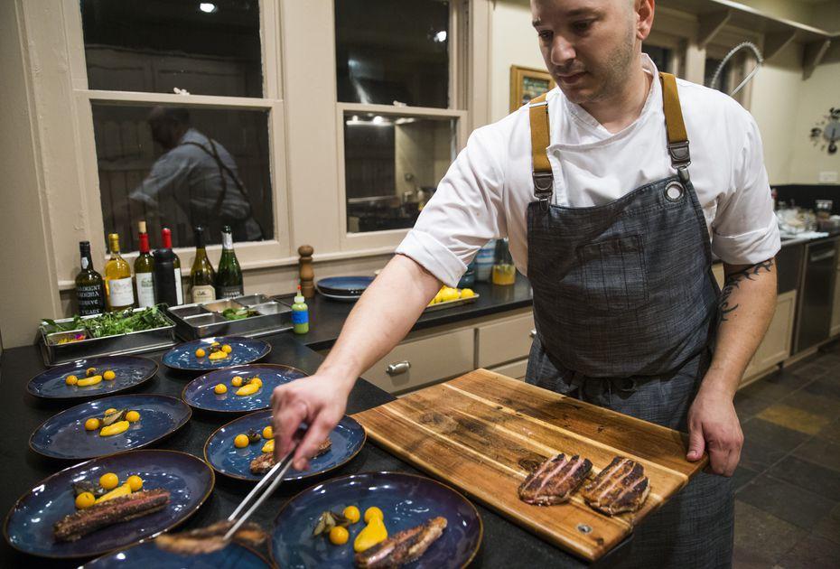 Chef Casey La Rue plates duck with squash at an Airbnb in Dallas.
