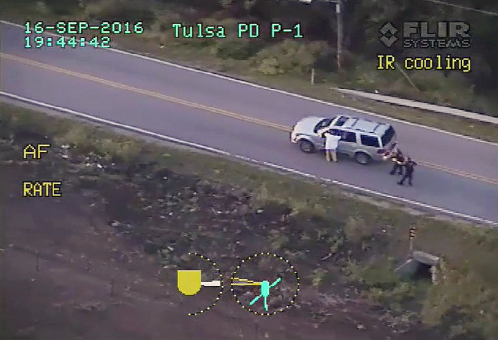 Terence Crutcher is shown with his arms up as he is pursued by police officers near his stalled SUV moments before he was shot and killed.